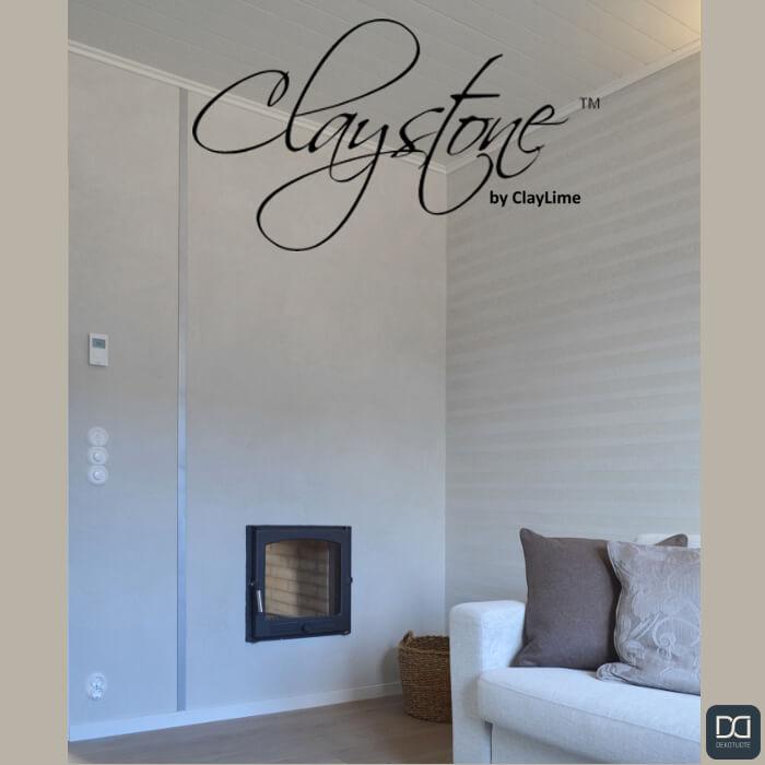 claystone-sisustuslaasti-takkahuone-takka-raitaseina-sohva-glasier