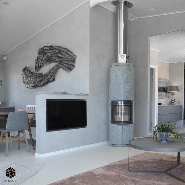 claystone-sisustuslaasti-harmaa-concrete-olohuone-ruokatila-takka-loma-asuntomessut-dekotuote